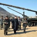 This undated picture released by North Korea's official Korean Central News Agency on March 12, 2013 shows North Korean leader Kim Jong Un (C) inspecting a long-range artillery sub-unit of Korean People's Army Unit 641 at undisclosed place in North Korea.   AFP / Getty Images / KCNA via KNS