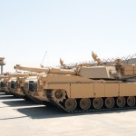 M1A1 Abrams tanks sit parked at a secured compound at the Besmaya Combat Training Center. The last shipment of M1A1 Abrams tanks arrived mid-August completing the Government of Iraq's purchase of 140 tanks through a Foreign Military Sales agreement with the United States.  — Photo by Army Staff Sgt. Edward Daileg