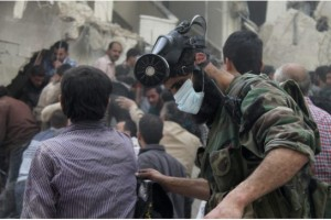 STRINGER / REUTERS FILE PHOTO  A man with a chemical mask on his head searches for survivors from the rubble of a damaged area, what activists said was a result of an airstrike by the Syrian Regime, in Al-Sukkari neighbourhood in Aleppo April 7, 2013.